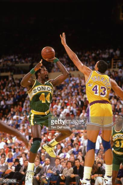 Michael Cage of the Seattle Supersonics goes up for the shot against Mychal Thompson of the Los Angeles Lakers during the 19881989 NBA season game at...