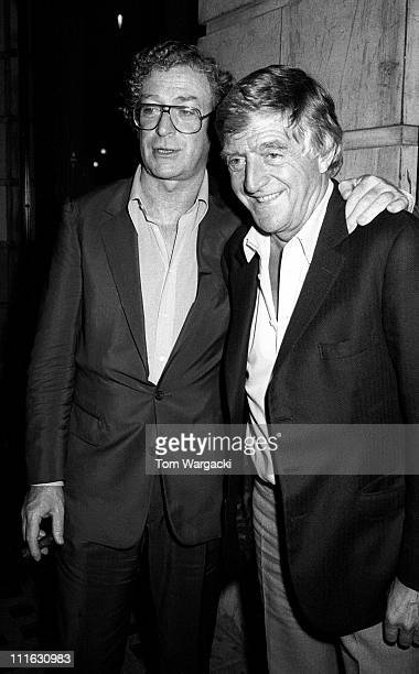 Michael Caine and Michael Parkinson during Michael Caine Sighting at Langan's Brasserie - 1987 at Langan's Brasserie in London, United Kingdom.