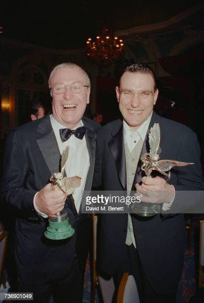 Michael Caine and Vinnie Jones holding awards at the Evening Standard Film Awards at the Savoy Hotel London 7th February 1999
