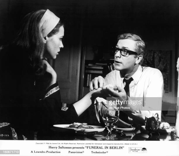 Michael Caine as Harry Palmer holding hand of Eva Renzi in a scene from the film 'Funeral In Berlin' 1966