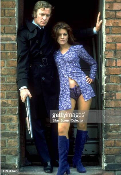 Michael Caine, British actor, holding a shotgun, Geraldine Moffat, British actress, pose in a doorway in a publicity portrait issued for the film,...