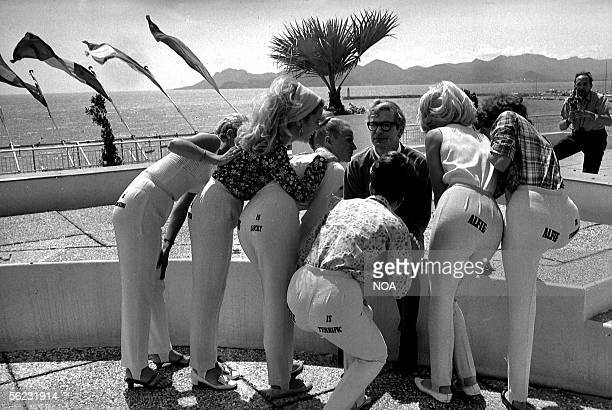 Michael Caine British actor with models for the promotion of his film Alfie produced by Lewis Gilbert Festival of Cannes 1966 HA106721