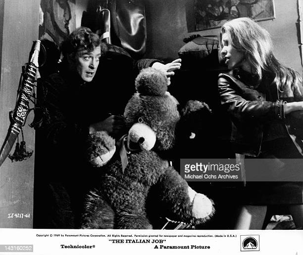 Michael Caine holding giant teddy bear as Margaret Blye takes a swing at him in a scene from the film 'The Italian Job' 1969