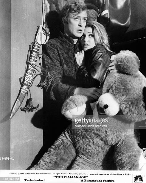 Michael Caine holding onto Margaret Blye in a scene from the film 'The Italian Job' 1969