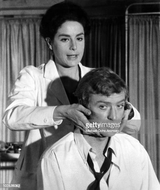 Michael Caine portrays Alfie Elkins as he gets checked by the doctor Eleanor Bron in a scene from the movie Alfiewhich was released on August 24 1966