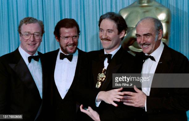 Michael Caine, Roger Moore, Oscar winner Kevin Kline and Sean Connery backstage at the 61st Annual Academy Awards Show at the Shrine Auditorium,...