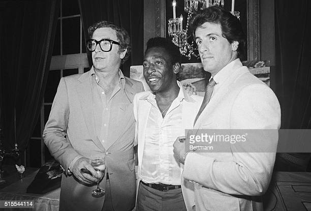 "Michael Caine, soccer great Pele, and Sylvester Stallone at a party celebrating the 7/16 opening of the film ""Victory"" in which all three star."