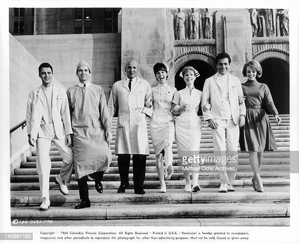 Michael Callan Dean Jones Telly Savalas Stephanie Powers Barbara Eden George Segal Inger Stevens walking down hospital steps in a scene from the film...