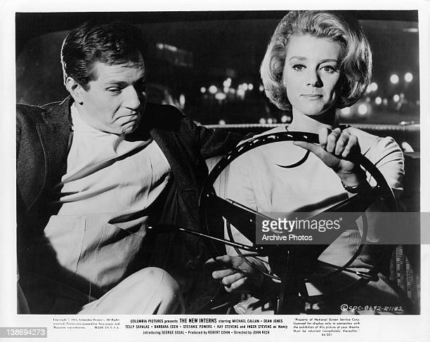 Michael Callan sitting with Inger Stevens as she drives in a scene from the film 'The New Interns' 1964