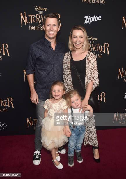 Michael Cameron Beverley Mitchell Kenzie Cameron and Hutton Michael Cameron arrive at the world premiere of Disney's The Nutcracker and the Four...