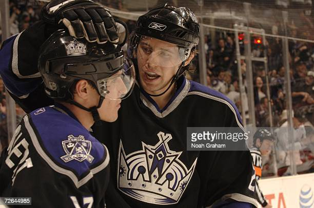 Michael Cammalleri and Alexander Frolov of the Los Angeles Kings celebrate after a goal against the Calgary Flames on November 25 2006 at the Staples...