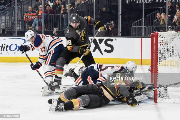 Michael Cammalleri and Darnell Nurse of the Edmonton Oilers defend their goal against Alex Tuch and Cody Eakin of the Vegas Golden Knights during the...