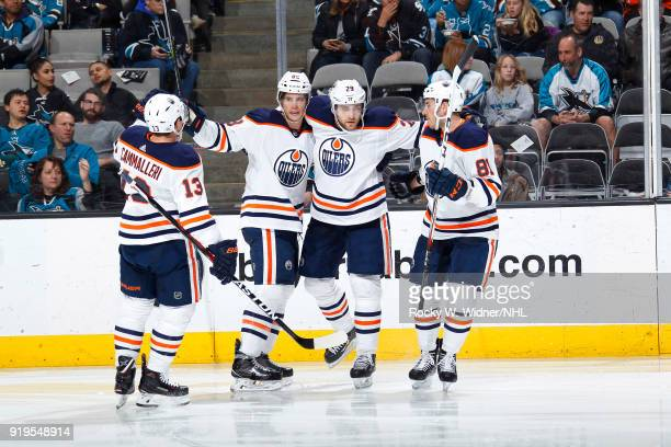 Michael Cammalleri Brandon Davidson Leon Draisaitl and Yohann Auvitu of the Edmonton Oilers celebrate after scoring a goal against the San Jose...