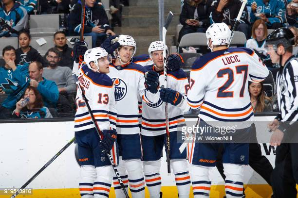 Michael Cammalleri Brandon Davidson Yohann Auvitu and Milan Lucic of the Edmonton Oilers celebrate after scoring a goal against the San Jose Sharks...