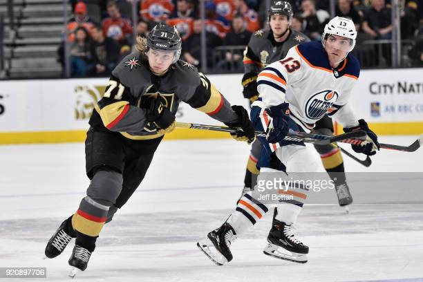 Michael Cammalleri of the Edmonton Oilers and William Karlsson of the Vegas Golden Knights skate to the puck during the game at TMobile Arena on...