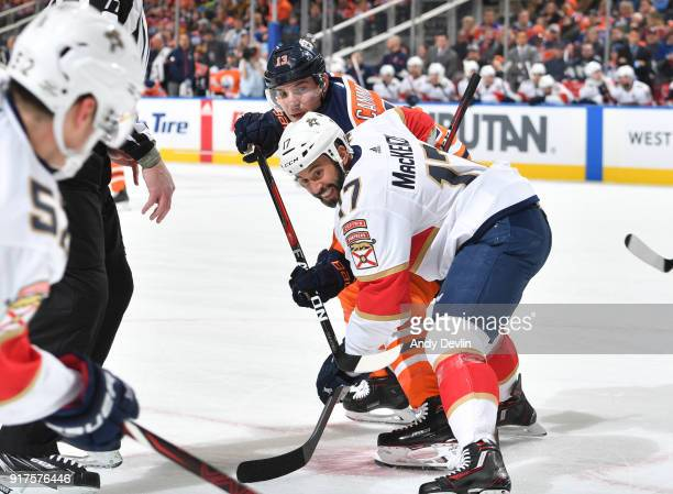 Michael Cammalleri of the Edmonton Oilers battles for the puck against Derek MacKenzie of the Florida Panthers on February 12 2018 at Rogers Place in...