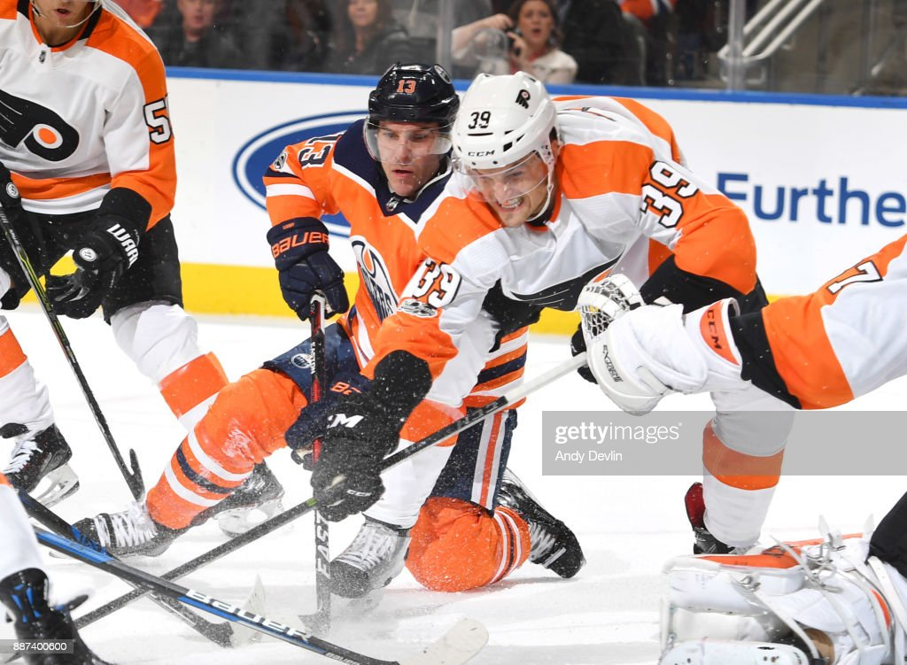 Michael Cammalleri #13 of the Edmonton Oilers battles for the puck against Mark Alt #39 of the Philadelphia Flyers on December 6, 2017 at Rogers Place in Edmonton, Alberta, Canada.