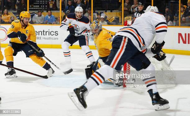Michael Cammalleri of the Edmonton Oilers puts the puck on net against Pekka Rinne of the Nashville Predators during an NHL game at Bridgestone Arena...