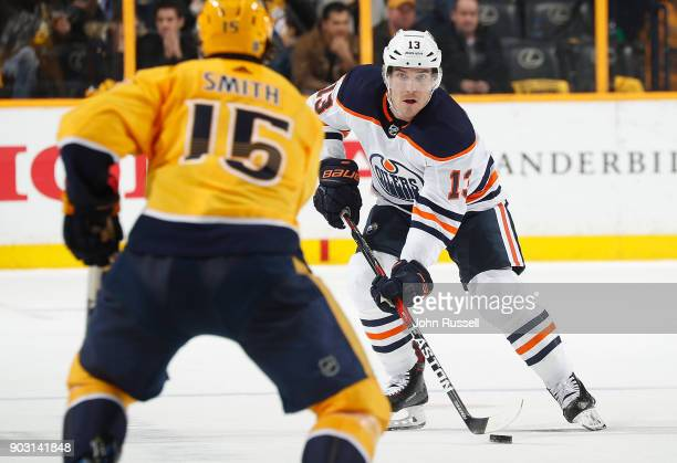 Michael Cammalleri of the Edmonton Oilers skates against Craig Smith of the Nashville Predators during an NHL game at Bridgestone Arena on January 9...