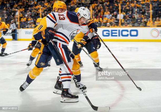 Michael Cammalleri of the Edmonton Oilers skates against Kyle Turris of the Nashville Predators during an NHL game at Bridgestone Arena on January 9...