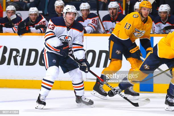 Michael Cammalleri of the Edmonton Oilers skates against Nick Bonino of the Nashville Predators during the third period at Bridgestone Arena on...