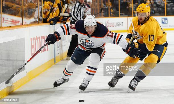 Michael Cammalleri of the Edmonton Oilers skates against Nick Bonino of the Nashville Predators during an NHL game at Bridgestone Arena on January 9...