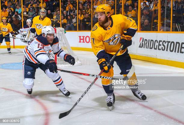 Michael Cammalleri of the Edmonton Oilers skates against Yannick Weber of the Nashville Predators during the second period at Bridgestone Arena on...
