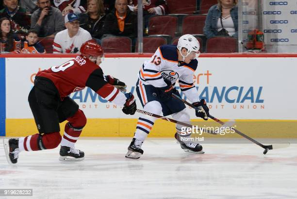 Michael Cammalleri of the Edmonton Oilers skates with the puck as Clayton Keller of the Arizona Coyotes defends during the first period at Gila River...