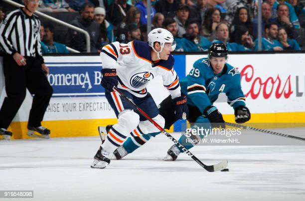 Michael Cammalleri of the Edmonton Oilers skates with the puck against Logan Couture of the San Jose Sharks at SAP Center on February 10 2018 in San...