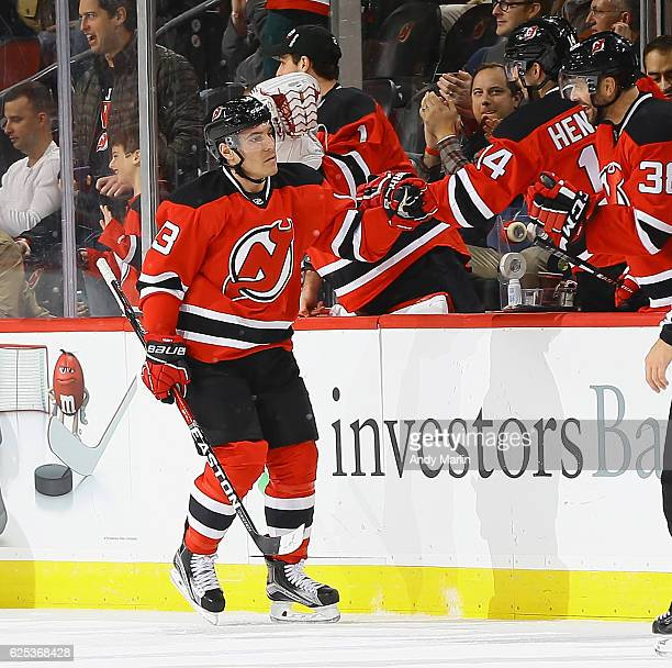 Michael Cammalleri of the New Jersey Devils is congratulated by his teammates after scoring a secondperiod goal against the Toronto Maple Leafs...