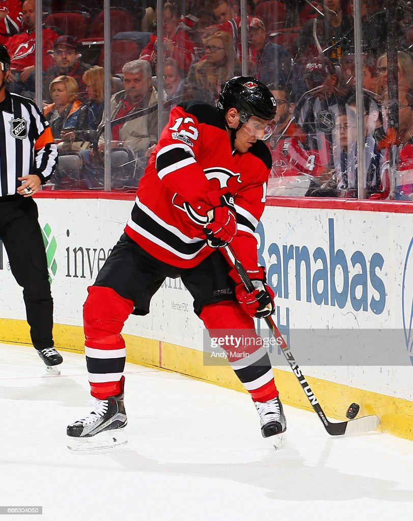 Michael Cammalleri #13 of the New Jersey Devils plays the puck against the New York Islanders during the game at Prudential Center on April 8, 2017 in Newark, New Jersey.
