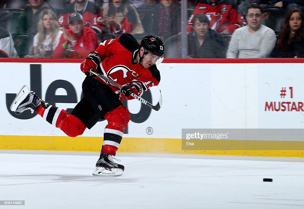 Michael Cammalleri #13 of the New Jersey Devils takes a shot in the second period against the Vancouver Canucks on December 6, 2016 at Prudential Center in Newark, New Jersey.