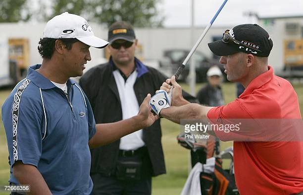 Michael Campbell of New Zealand gives advice to Stephen Scahill of New Zealand on the driving range during the New Zealand Open Pro Am at the Gulf...