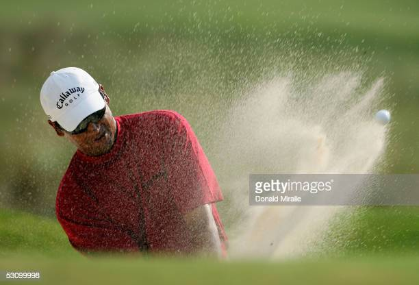 Michael Campbell of New Zealand plays a bunker shot on the 12th hole during round three of the U.S. Open on Pinehurst No. 2 at the Pinehurst Resort...