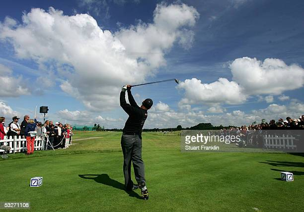 Michael Campbell of New Zealand plays his tee shot on the first hole during the delayed first round of The Deutsche Bank Players Championship on July...