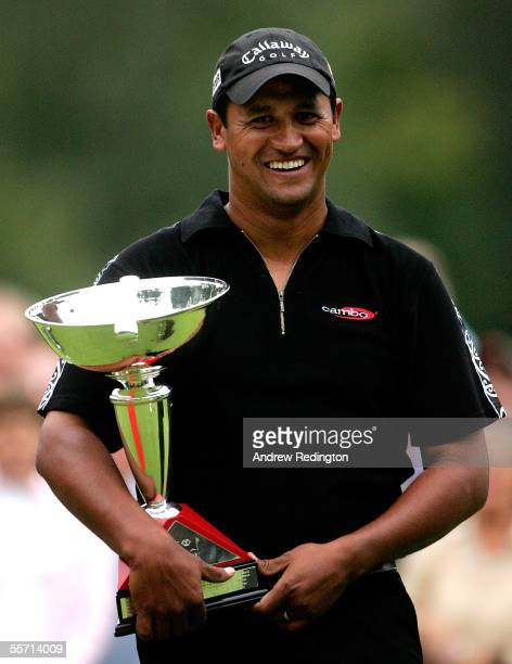 Michael Campbell of New Zealand poses with the trophy after winning The HSBC World Match Play Championship on September 18 2005 at Wentworth Club in...