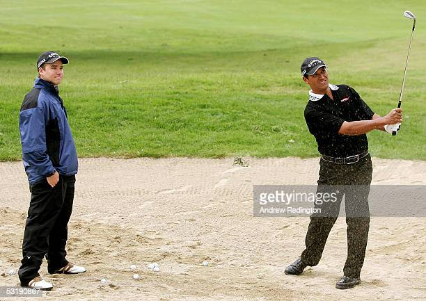 Michael Campbell of New Zealand practices under the eye of sports psychologist Nick Hastings prior to the final round of the Smurfit European Open on...