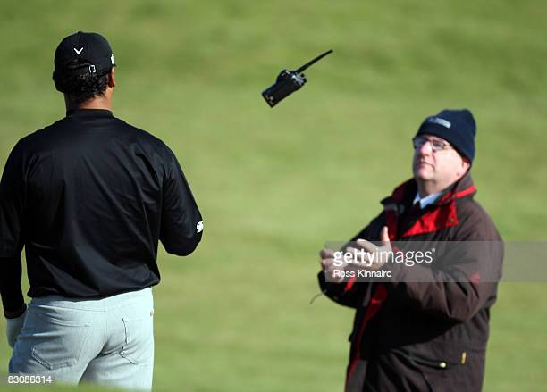 Michael Campbell of New Zealand receives a radio to talk to a rules official on the 13th hole during the first round of The Alfred Dunhill Links...