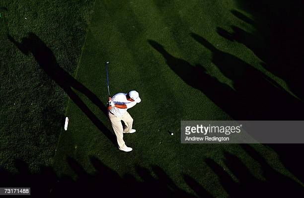 Michael Campbell of New Zealand tees off on the 17th hole during the first round of the Dubai Desert Classic on the Majilis Course at Emirates Golf...