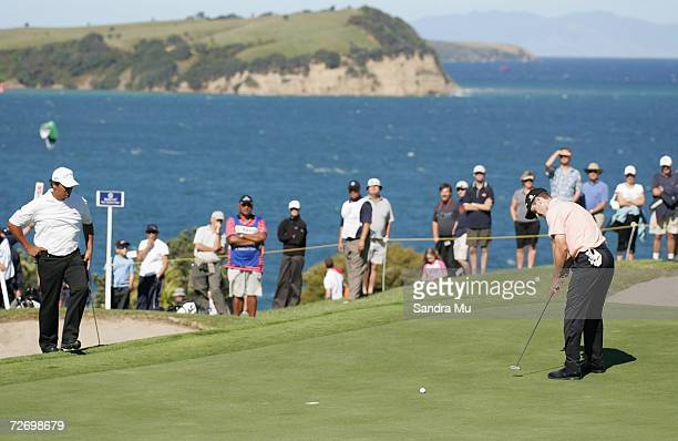 Michael Campbell of New Zealand watches Scott Strange make a putt on the 15th hole during round three of the New Zealand Open at Gulf Harbour Country...