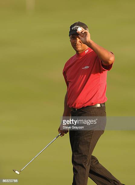 Michael Campbell reacts to the gallery on the 18th green during the third round of the PGA TOUR's 2006 Mercedes Championships at The Plantation At...