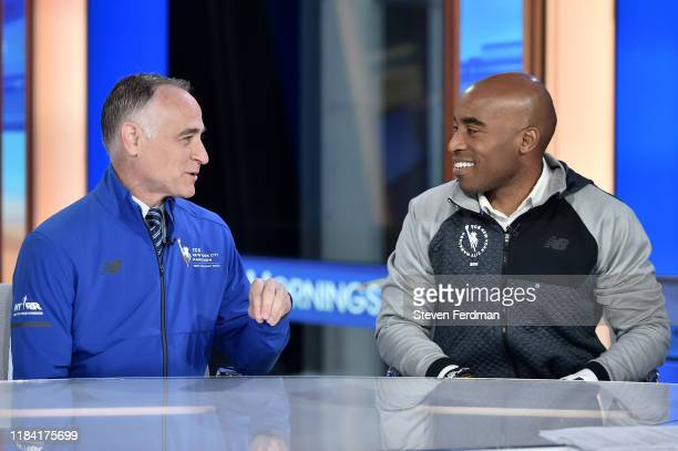 "Michael Capiraso and Tiki Barber visit ""Mornings With Maria"" at Fox News Channel Studios on October 29, 2019 in New York City."