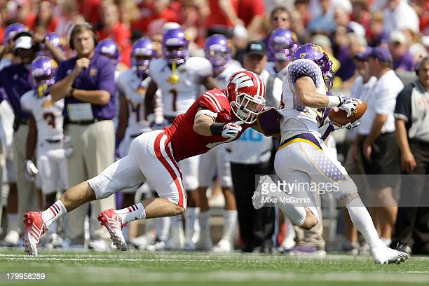 Michael Caputo of the Wisconsin Badgers tackles Peniel Jean of the Tennessee Tech Golden Eagles during the game at Camp Randall Stadium on September...