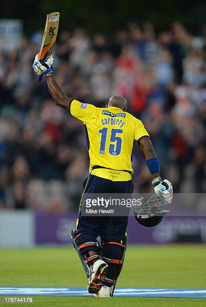 Michael Carberry of Hampshire celebrates after reaching his century during the Friends Life T20 Quarter Final between Hampshire Royals and Lancashire...