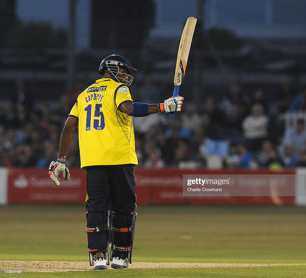 Michael Carberry of Hampshire celebrates his half century during the Friends Life T20 match between Sussex Sharks and Hampshire Royals at The Brighton and Hove Jobs County Ground on July 05, 2013 in Hove, England.