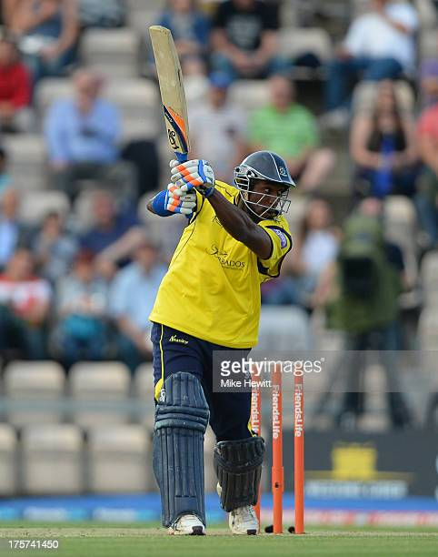 Michael Carberry of Hampshire drives for four during the Friends Life T20 Quarter Final between Hampshire Royals and Lancashire Lightning at Ageas...