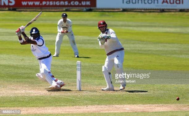 Michael Carberry of Hampshire hits out past Steve Davies of Somerset during Day Two of The Specsavers County Championship Division One match between...
