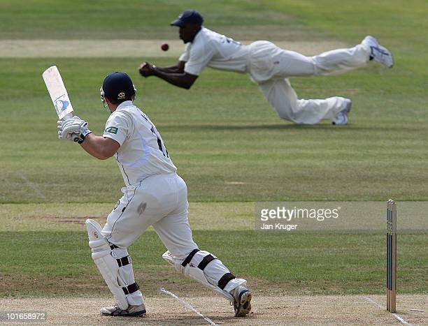Michael Carberry of Hampshire spills a catch after a cut shot from Graham Napier of Essex during the LV County Championship Division One match...