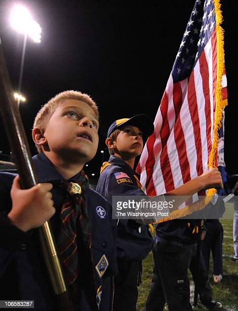 Michael Carlo 9 and Antonio Labera 7 stand ready to bring the colors onto the field before the Dominion vs Briar Woods football game on November 5...