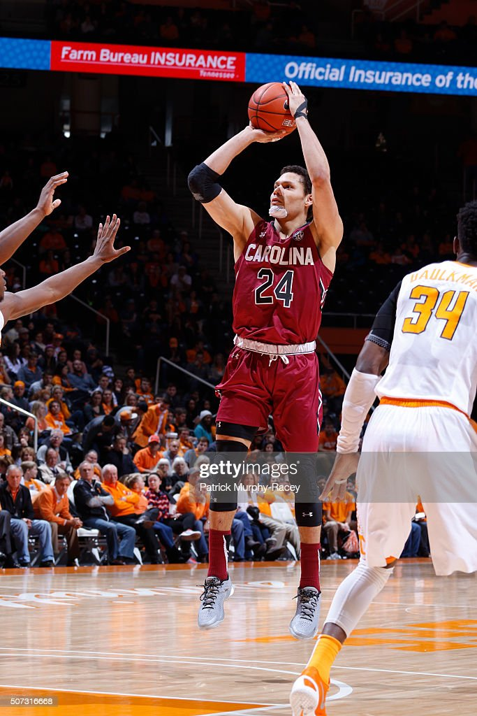Michael Carrera #24 of the South Carolina Gamecocks shoots against the Tennessee Volunteers in a game at Thompson-Boling Arena on January 23, 2016 in Knoxville, Tennessee.